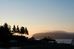 Looking over the spit at Gig Harbor to a fog-enshrouded Point Defiance. Photo