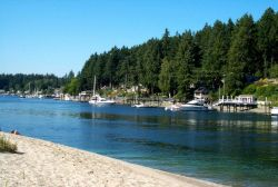 A view of private boat docks from one of the few sandy beach areas in the Gig Harbor area. Photo