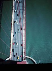 View from the top of the south tower of the Golden Gate Bridge looking down onto the deck of the bridge Photo