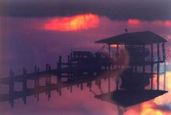 Patuxent River sunset with reflections on a calm river. Photo