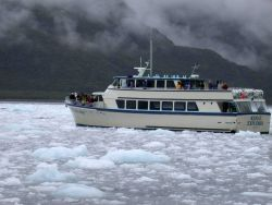 Tourist vessel Kenai Explorer in Kenai Fjords area. Photo