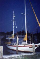 Sailboat at pier along the South River. Photo