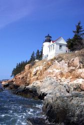 Bass Harbor Head Lighthouse from below and looking east at the shoreline. Photo