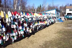 Floats for lobster traps adorning a Maine fence. Photo