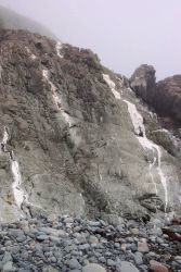 Metamorphic rocks smoothed by the surf at West Quoddy Head. Photo