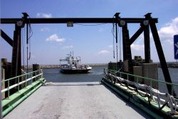The Cedar Island to Ocracoke ferry boat CARTERET maneuvering to dock at Cedar Island. Photo