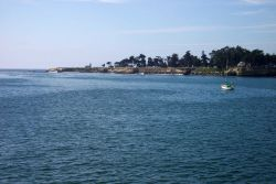 Santa Cruz Lighthouse Point, Steamers Land, and West Cliff Drive as seen from the Santa Cruz Wharf. Photo