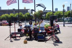 Musicians plying their trade near the crab sculpture at Pier 39. Photo