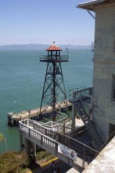 An Alcatraz guard tower overlooking the pier area. Photo