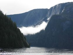 A ribbon of cloud draped across a glacial valley in the Rudyerd Bay area. Photo