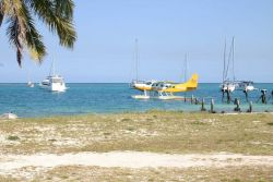 Seaplane taxiing with yachts anchored offshore at Fort Jefferson. Photo