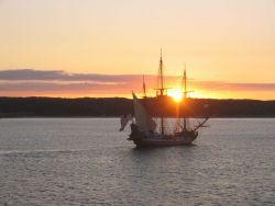 Delaware's tall ship, the KALMAR NYCKEL, sailing into the sunset Photo