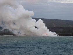 Lava flow entering the sea on SE coast of Hawaii. Photo