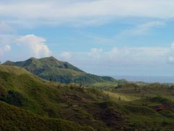 Mountains of Guam and a military antenna farm. Photo