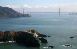 A magnificent view of the Point Bonita Lighthouse with the Golden Gate Bridge in the background. Photo