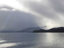 Light, sun, and clouds along the Inside Passage Photo