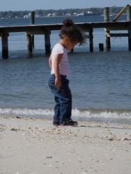 A young beachcomber looking for treasure. Photo