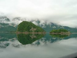 Magnificent scenery of Geographic Harbor reflected off still waters. Photo