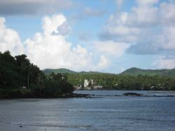 A church seen at the end of a bay on the western coast Photo