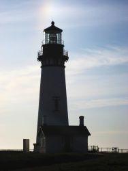 Yaquina Head Lighthouse with a sundog overhead Photo