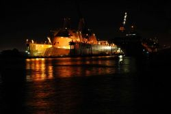 A Norfolk area shipyard seen at night. Photo