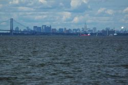 Looking over the east end of the Verrazano Narrows Bridge to Brooklyn and the New York Manhattan skyline beyond Photo