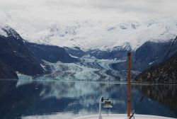 The NOAA Ship FAIRWEATHER's ships bell with Johns Hopkins Glacier in the background. Photo
