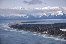 An aerial view of the south entrance to Icy Bay showing the great sandspit and the endless surf of the Gulf of Alaska. Image