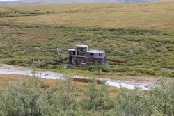 A deserted gold dredge outside Nome, Alaska, in the watershed of the Nome River. Image
