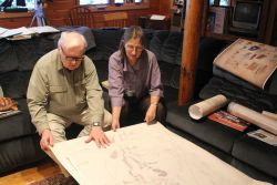 Kathy and William Ruddy, noted Alaskan historians, ethnographers, and legal authorities, examining the Kohklux map brought by Dr Photo