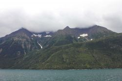 A scene on Lynn Canal with cloud-shrouded mountain peaks. Image