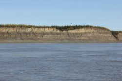A scene along the MacKenzie River, the second longest river in North America and the largest north flowing river. Image