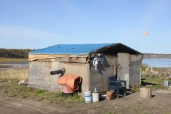 A fish smokehouse in Tsiigehtchic at the junction of the Arctic Red River and the Mackenzie River. Image