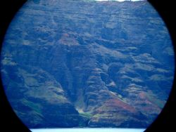 A telescopic view from offshore of the Na Pali coastline. Image