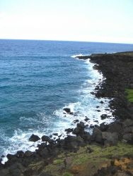 Basaltic boulders doing battle with the sea Photo