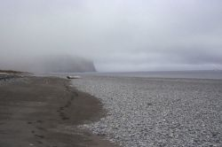 A lonely cobble and sand beach in the Aleutians. Image