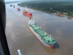 A few of the 70 or so vessels waiting to transit the Mississippi River following the collision of a fuel barge and a chemical tanker resulting in the  Photo
