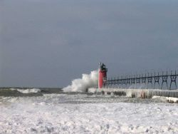 South Haven Lighthouse in a winter storm Photo