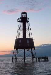 Carysfort Reef Lighthouse at sunset Photo