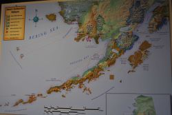 Map of Alaska at Anchorage Airport showing Alaska's Southwestern Wildlands and various aircraft flight routes. Photo