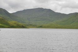 Looking up a bay to the switchback road into the mountains above Dutch Harbor. Photo