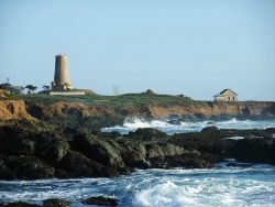 Looking south to the Point Piedras Blancas lighthouse over the shoreline at a high tide Photo