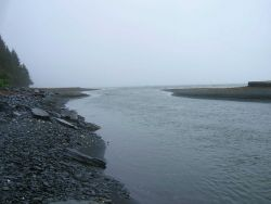 A river debouching in the sea. Photo