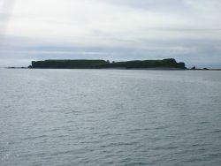 A flat-topped island seen departing Kodiak. Photo