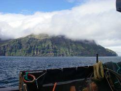 An Aleutian Island shrouded by fog. Photo
