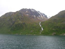 A waterfall rushing to the sea on Kodiak Island. Photo