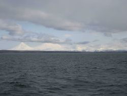 Pavlof Sister and Pavlof Volcano from the north side of the Alaska Peninsula. Photo