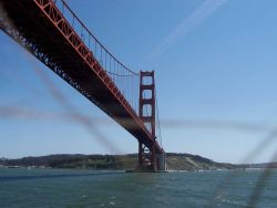 South pier of the Golden Gate Bridge seen looking back as the MILLER FREEMAN departs San Francisco Bay. Photo
