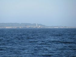 Point Arena Lighthouse seen from offshore. Photo