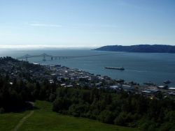 A merchant vessel approaching the Astoria-Megler Bridge as it is outbound headed to the Pacific Ocean. Photo